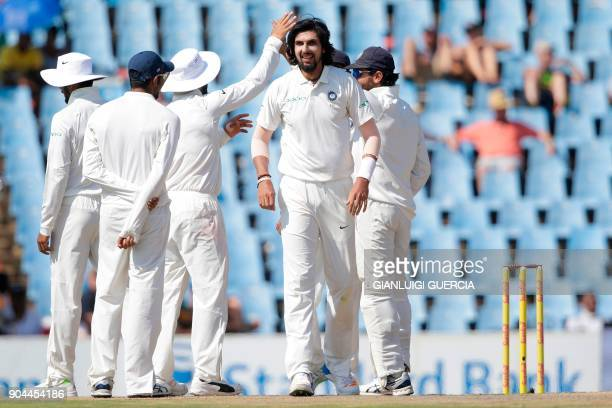 Indian cricketer Ishant Sharma and teammates celebrate the dismissal of South African batsman AB de Villiers during the first day of the second Test...