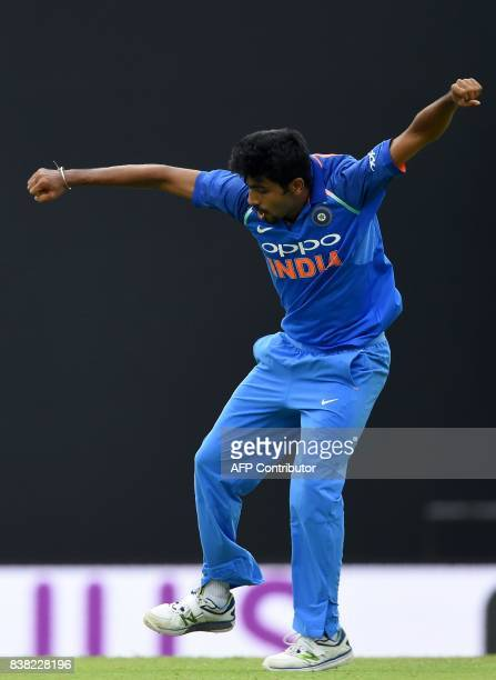 Indian cricketer Jasprit Bumrah celebrates after he dismissed Sri Lankan cricketer Niroshan Dickwella during the second one day international cricket...