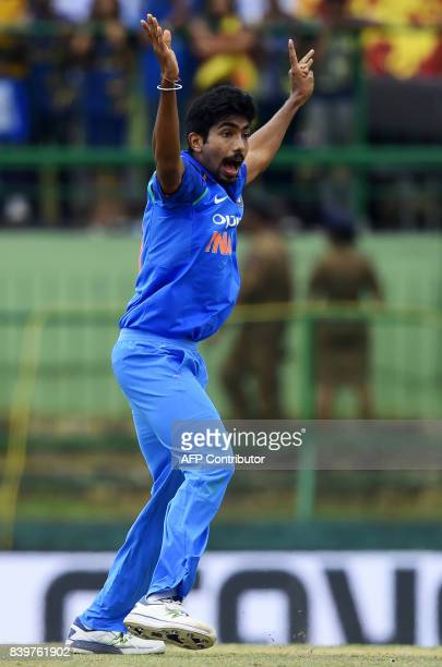 Indian cricketer Jasprit Bumrah celebrates after he dismissed Sri Lankan cricketer Niroshan Dickwella during the third one day international cricket...