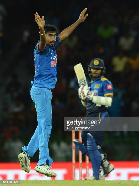 Indian cricketer Jasprit Bumrah celebrates after he dismissed Sri Lankan cricketer Dilshan Munaweera during the fourth one day international cricket...