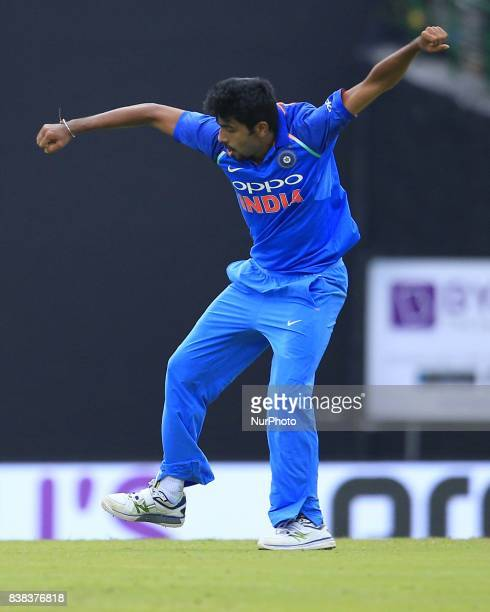 Indian cricketer Jasprit Bumrah celebrates after taking a a wicket during the 2nd One Day International cricket match between Sri Lanka and India at...