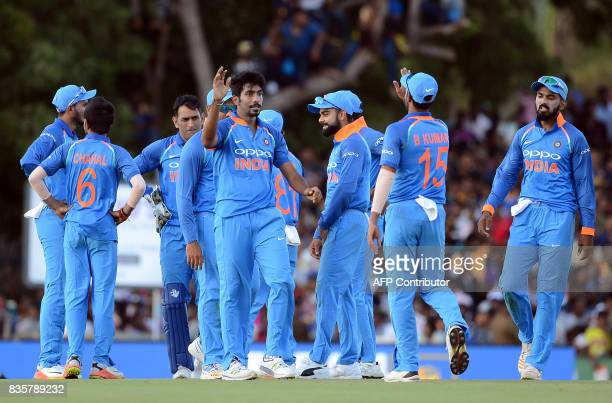 Indian cricketer Jasprit Bumrah celebrates with his teammates after he dismissed Sri Lankan cricketer Thisara Perera during the first One Day...