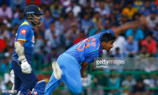 Indian cricketer Jasprit Bumrah delivers a ball during the 5th and final One Day International cricket match between Sri Lanka and India at the R...