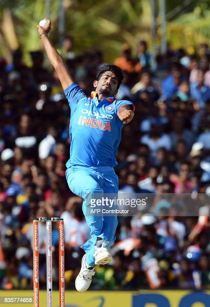 Indian cricketer Jasprit Bumrah delivers the ball during the first One Day International cricket match between Sri Lanka and India at the Rangiri...