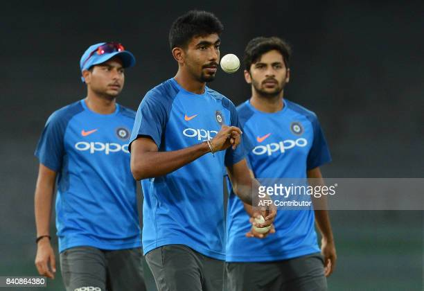 Indian cricketer Jasprit Bumrah tosses a ball during a practice session at The RPeremadasa Stadium in Colombo on August 30 2017 The fourth one day...