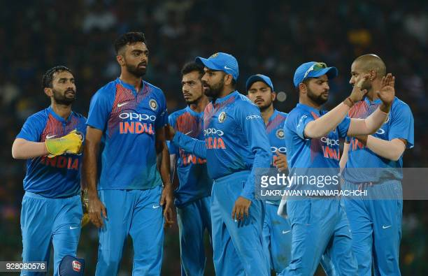 Indian cricketer Jaydev Unadkat celebrates with his teammates after he dismissed Sri Lankan cricketer Danushka Gunathilaka during the opening...