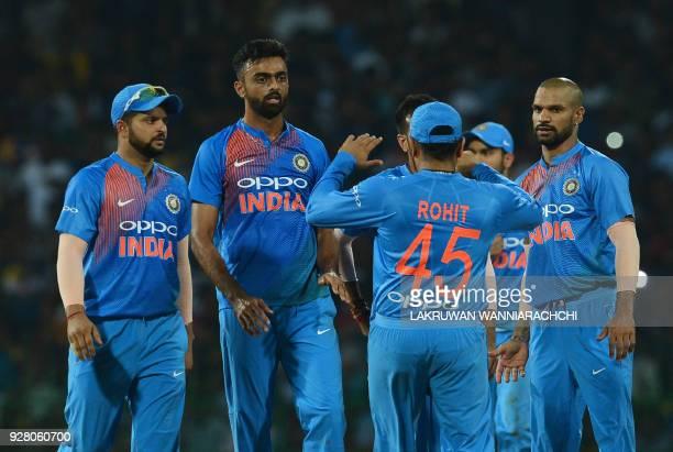 Indian cricketer Jaydev Unadkat celebrates with his teammates after he dismissed Sri Lankan cricketer Danushka Gunathilaka during the opening...