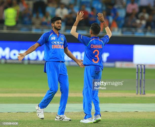 Indian cricketer K Khaleel Ahmed and Yuzvendra Chahal celebrate after taking a wicket during the 4th cricket match of Asia Cup 2018 between India and...