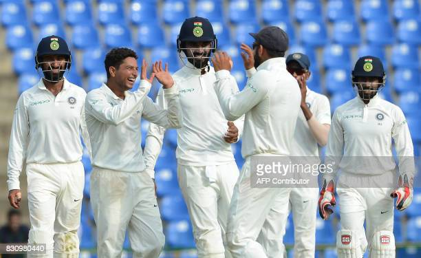 Indian cricketer Kuldeep Yadav celebrates with his teammates after he dismissed Sri Lankan cricketer Vishwa Fernando during the second day of the...
