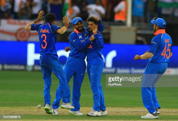 Indian cricketer Kuldeep Yadhav celebrates during the final cricket match of Asia Cup 2018 between India and Bangladesh at Dubai International...