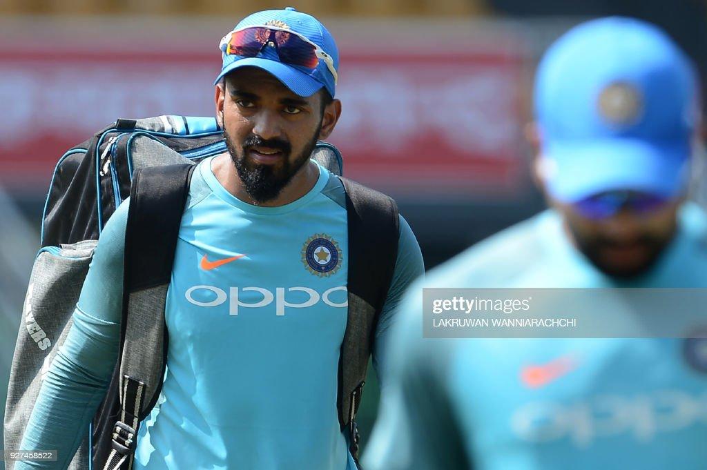 Indian cricketer Lokesh Rahul (L) walks during a taining session at the R.Premadasa Stadium in Colombo on March 5, 2018. The Nidahas Trophy tri-nation Twenty20 tournament involving Sri Lanka, Bangladesh and India starts in Colombo on March 6. /
