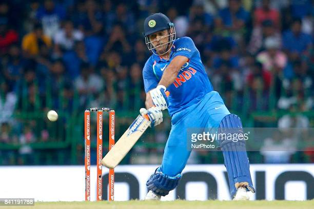 Indian cricketer M S Dhoni plays a shot during the 4th One Day International cricket match between Sri Lanka and India at the R Premadasa...