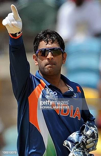 Indian cricketer Mahendra Singh Dhoni makes field placement during yhe ICC World Twenty20 Super 8 match between Australia and India at the Kensington...