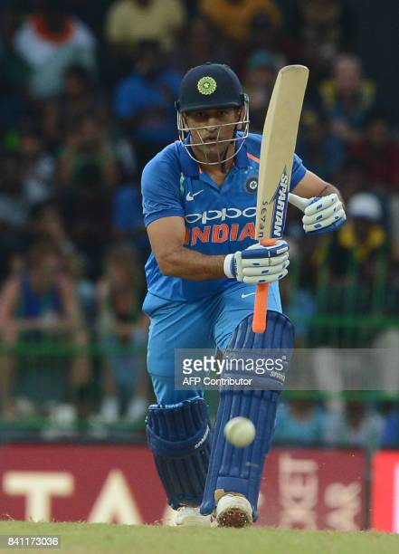 Indian cricketer Mahendra Singh Dhoni plays a shot during the fourth one day international cricket match between Sri Lanka and India at R Premadasa...