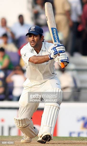Indian cricketer Mahendra Singh Dhoni plays a shot on the fourth day of the fourth and final Test match of the Border-Gavaskar Trophy 2008 series...