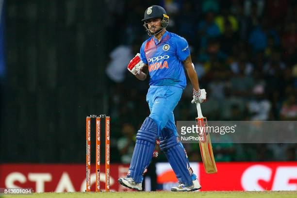 Indian cricketer Manish Pandey gestures after hitting the winning runs during the 1st and only T20 cricket match between Sri Lanka and India at R...