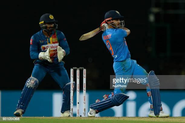 Indian cricketer Manish Pandey plays a shot during the 4th Twenty20 cricket match of NIDAHAS Trophy between Sri Lanka and India at R Premadasa...