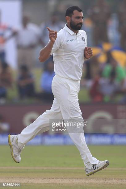 Indian cricketer Mohammed Shami celebrates during the 2nd Day's play in the 1st Test match between Sri Lanka and India at the Galle International...