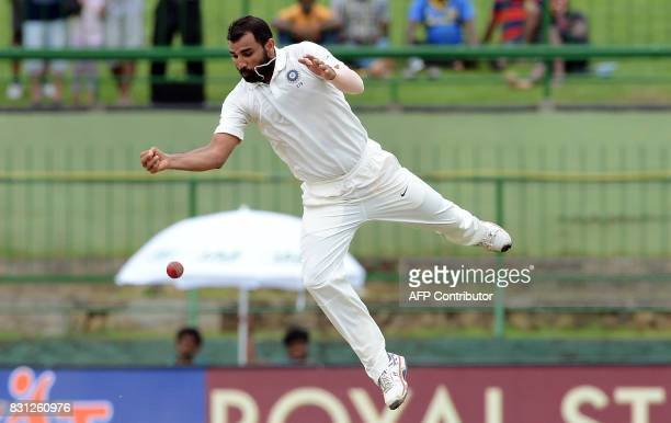 Indian cricketer Mohammed Shami drops a catch off Sri Lankan cricketer Lahiru Kumara during the third day of the third and final Test match between...