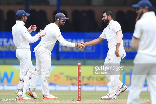 Indian cricketer Mohammed Shami is congratulated by India's Ajinkya Rahane during the 3rd Day's play in the 2nd Test match between Sri Lanka and...