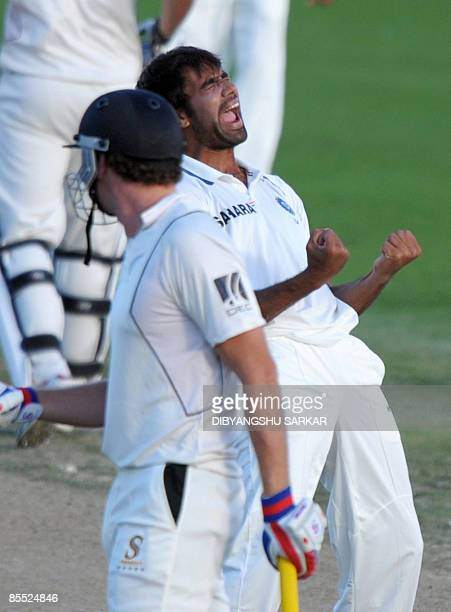 Indian cricketer Munaf Patel celebrates the wicket of New Zealand batsman Kyle Mills during the third day of the first Test match between India and...
