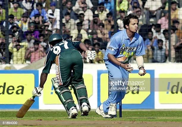 Indian cricketer Murali Kartik takes a catch to dismiss Bangladeshi batsman Mohammad Ashraful during the second One Day International match between...