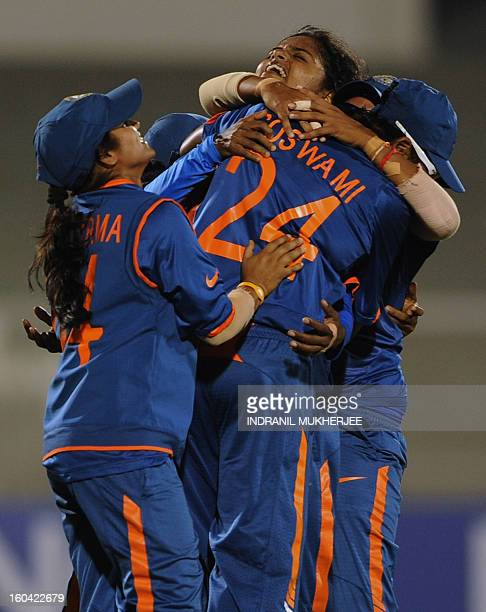 Indian cricketer Niranjana Nagarajan is congratulated by teammates after taking the wicket of West Indian cricketer Deandra Dottin during the...