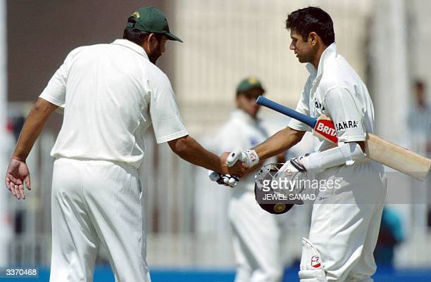 Indian cricketer Rahul Dravid is congratulated by Pakistani captain Inzamamul Haq after he reached his double century during the third day of the...