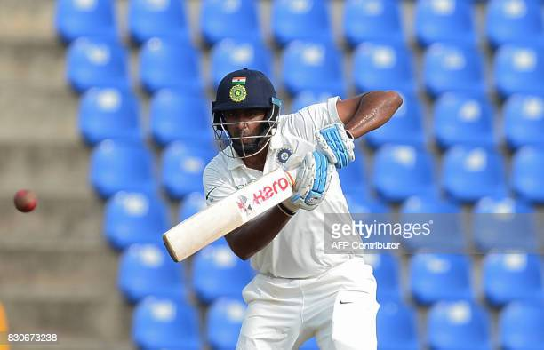 Indian cricketer Ravichandran Ashwin plays a shot during the first day of the third and final Test match between Sri Lanka and India at the Pallekele...