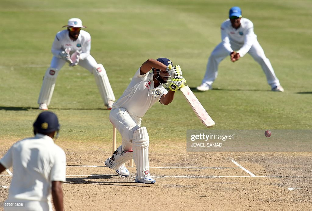 Indian cricketer Ravindra Jadeja (C) plays a shot during Day 2 of the three-day tour match between India and WICB President's XI squad at the Warner Park stadium in Basseterre, Saint Kitts, on July 15, 2016. / AFP / Jewel SAMAD