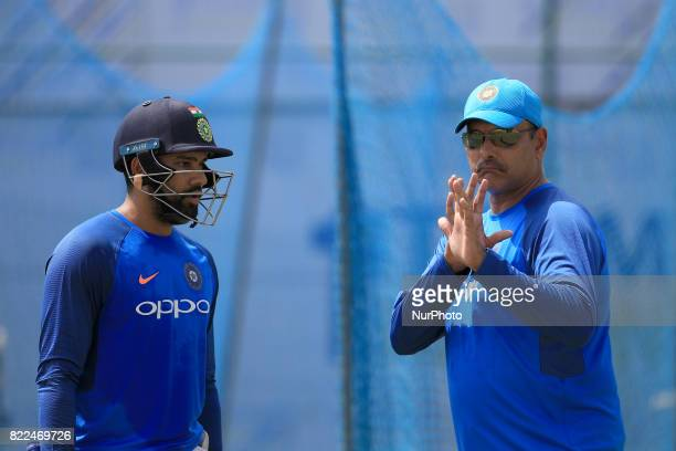 Indian cricketer Rohit Sharma listens to Indian head coach Ravi Shastri during a practice session ahead of the 1st test match between Sri Lanka and...