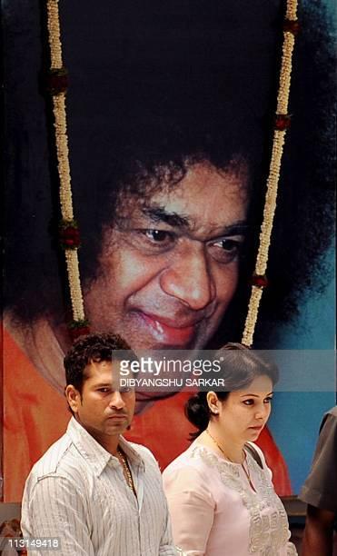 Indian cricketer Sachin Tendulkar and wife Anjali pay their last respects to the Hindu guru Sathya Sai Baba inside Prashanthi Nilayam at Puttaparthi...