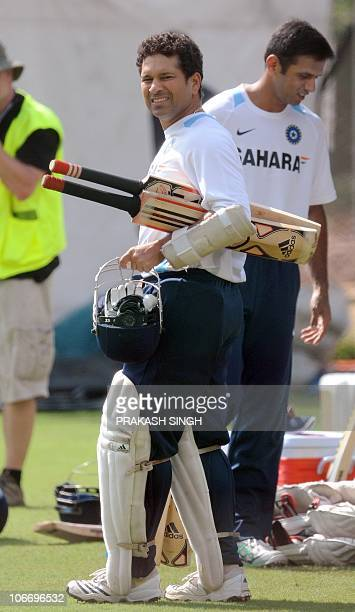 Indian cricketer Sachin Tendulkar arrives for batting in the nets during a training session at the Rajiv Gandhi International cricket stadium on the...