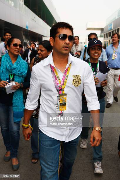 Indian cricketer Sachin Tendulkar arrives in the paddock before the Indian Formula One Grand Prix at the Buddh International Circuit on October 30...