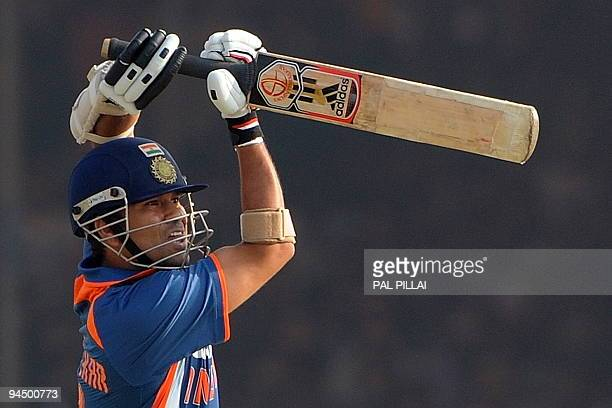 Indian cricketer Sachin Tendulkar bats during the first One-Day International in Rajkot on December 15, 2009. India scored their highest ever one-day...