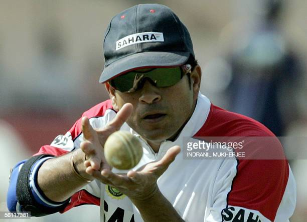Indian cricketer Sachin Tendulkar catches a ball during a fielding practice session on the eve of the sixth one day international match between India...