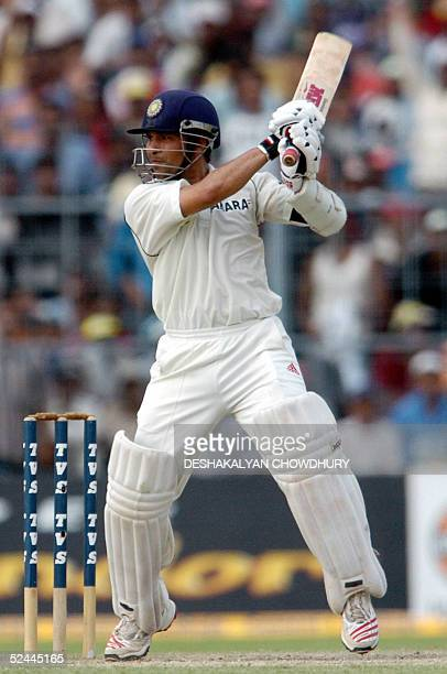 Indian cricketer Sachin Tendulkar eyes the ball during the third day of the second Test match between India and Pakistan at the Eden Gardens Stadium...