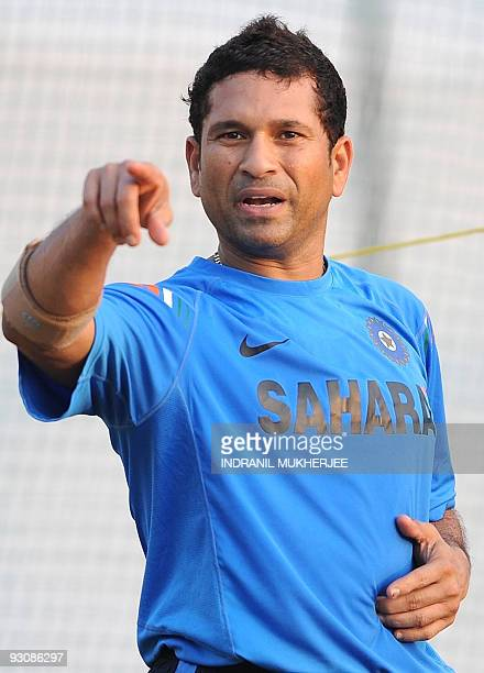 Indian cricketer Sachin Tendulkar gestures during a training session at the nets in Ahmedabad on November 14 2009 Tendulkar begins a third decade in...