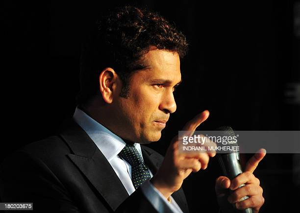 Indian cricketer Sachin Tendulkar gestures during an event to launch a specially designed 'cricket series television' which includes his input in...
