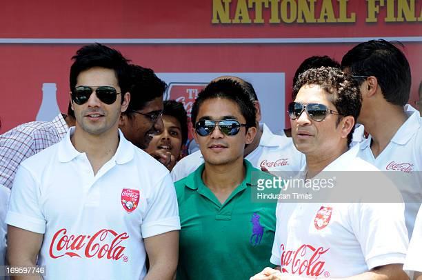 Indian cricketer Sachin Tendulkar Indian football team captian Sunil Chhetri and Bollywood actor Varun Dhawan at Fr Agnels Turf court during Coca...