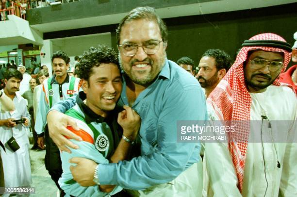 Indian cricketer Sachin Tendulkar is congraluted by an Indian supporter after India beat Australia in a final match in Sharjah 24 April.