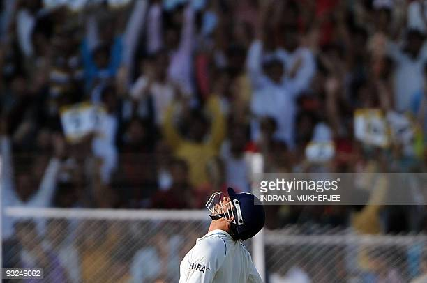 Indian cricketer Sachin Tendulkar looks skywards after reaching his century on the fifth day of the first test between India and Sri Lanka at the...