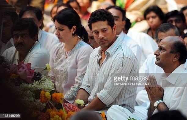 Indian cricketer Sachin Tendulkar pays his last respects to the Hindu guru Sathya Sai Baba inside Prashanthi Nilayam at Puttaparthi village some 200...