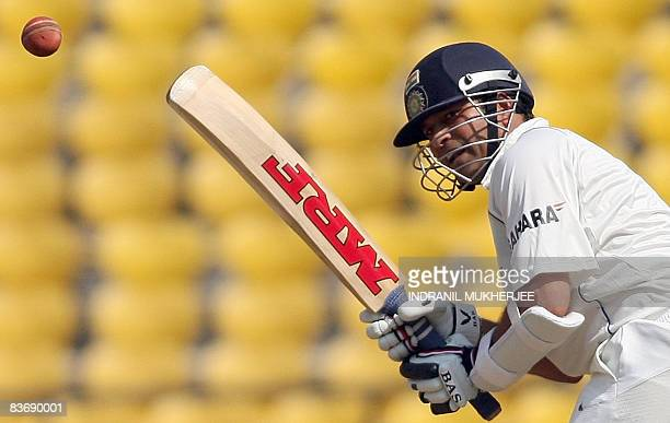 Indian cricketer Sachin Tendulkar plays a shot on the first day of the fourth and final Test match of the Gavaskar-Border Trophy 2008 series between...