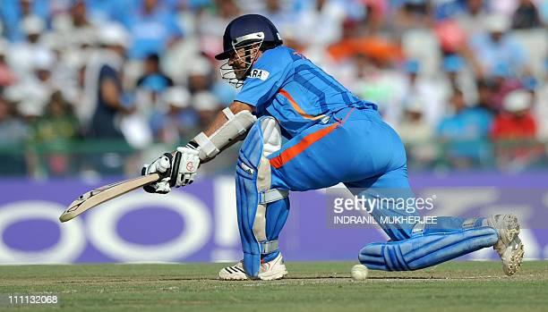 Indian cricketer Sachin Tendulkar plays a sweep shot during the ICC Cricket World Cup semifinal match between India and Pakistan at The Punjab...