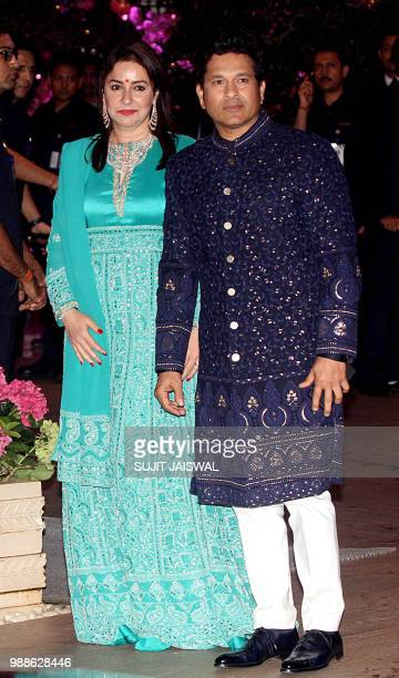Indian Cricketer Sachin Tendulkar poses for a picture with wife and actress Anjali as they attend the preengagement party of India's richest man and...