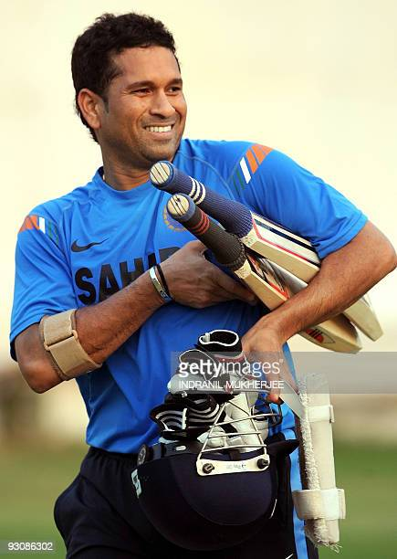 Indian cricketer Sachin Tendulkar reacts after a training session at the nets in Ahmedabad on November 14 2009 Tendulkar begins a third decade in...