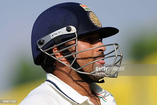 Indian cricketer Sachin Tendulkar reacts after missing his century during day three of the First Test match between India and Australia at Punjab...