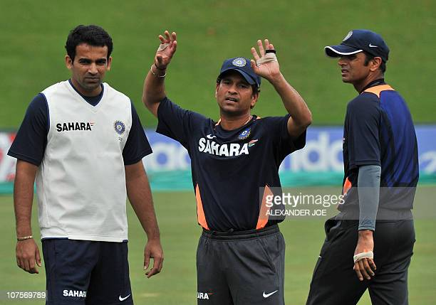 Indian cricketer Sachin Tendulkar reacts to a bad bowled as team mates Rahul Dravid and Zaheer Khan looks on during a training session at the Super...