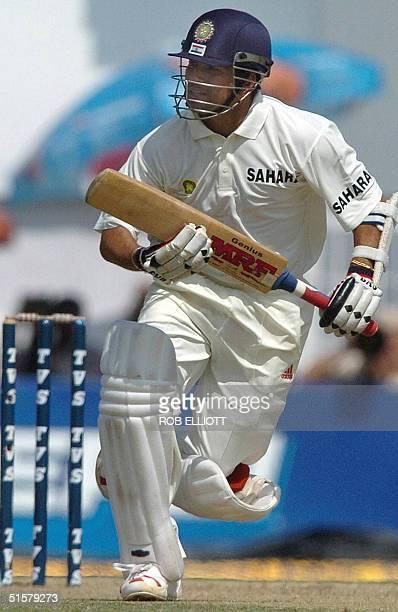 Indian cricketer Sachin Tendulkar runs between the wickets on the second day of the third Test match at The Vidarbha Cricket Association Stadium in...